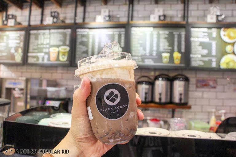 Black Scoop Cafe Milk Tea in UN Square, Manila