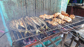 Fish and monkey on barbeque grill in Brazzaville