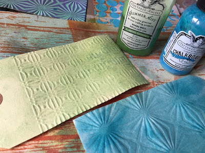 Embossed tags with lime & peacock blue mists.