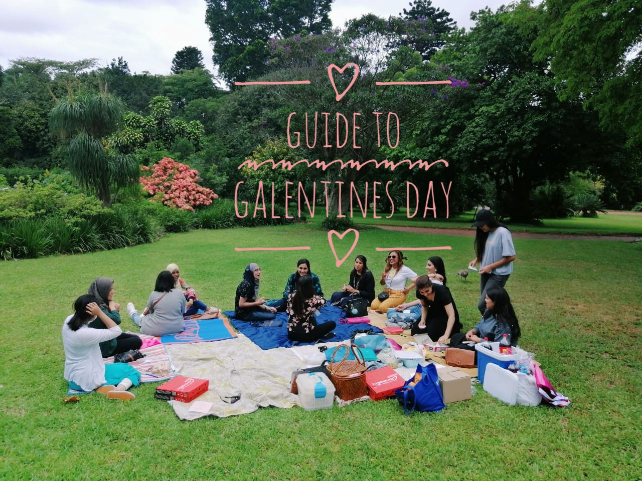 Galentines Day - a group of girl friends sitting in a circle at a park having a picnic