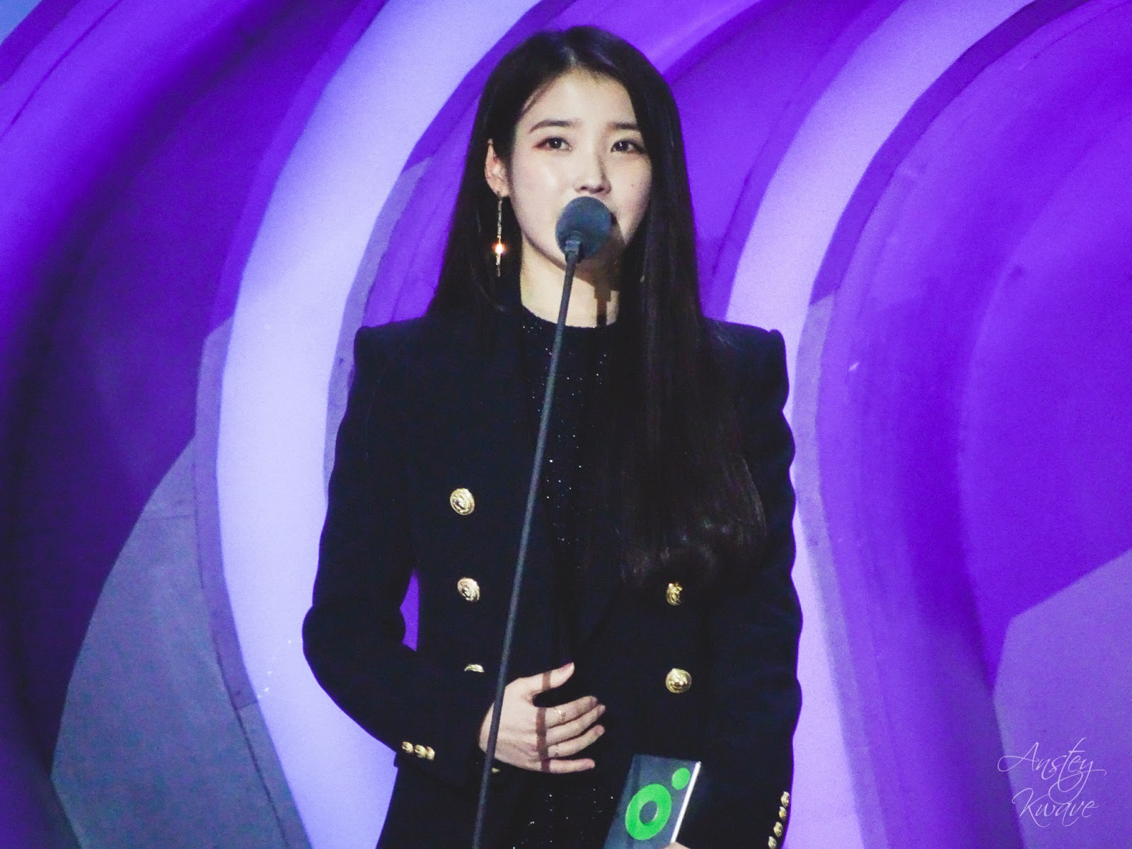 Famous Korean k-pop singer IU receiving award on stage at Melon Music Awards (MMA) 2017 in Seoul, South Korea