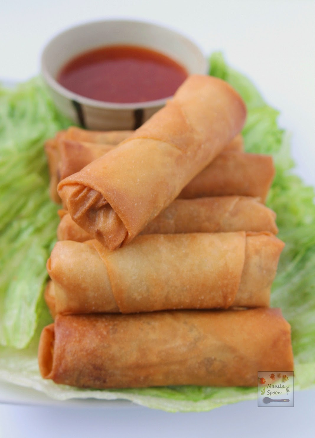 These crunchy and delicious spring rolls (Lumpia) are the perfect appetizers for any party and great for snacking, too. These can be made fully vegetarian or a little meat may be added, too. #easy #lumpia #vegetarian #appetizers #asian