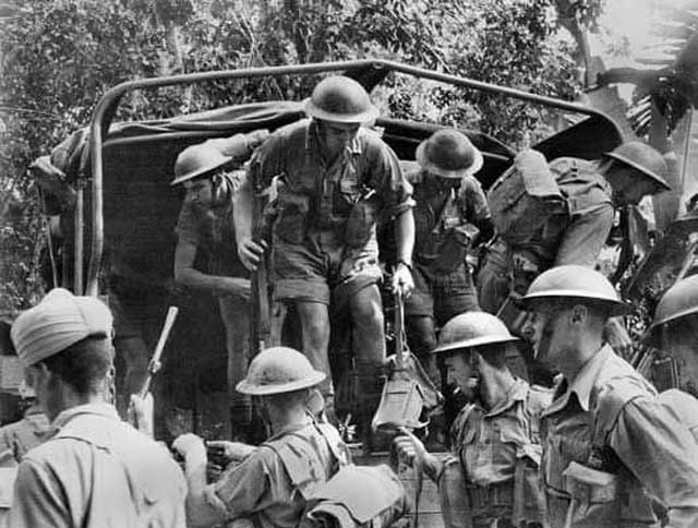 Australian troops after a tough battle on the Malay Peninsula, 14 January 1942 worldwartwo.filminspector.com