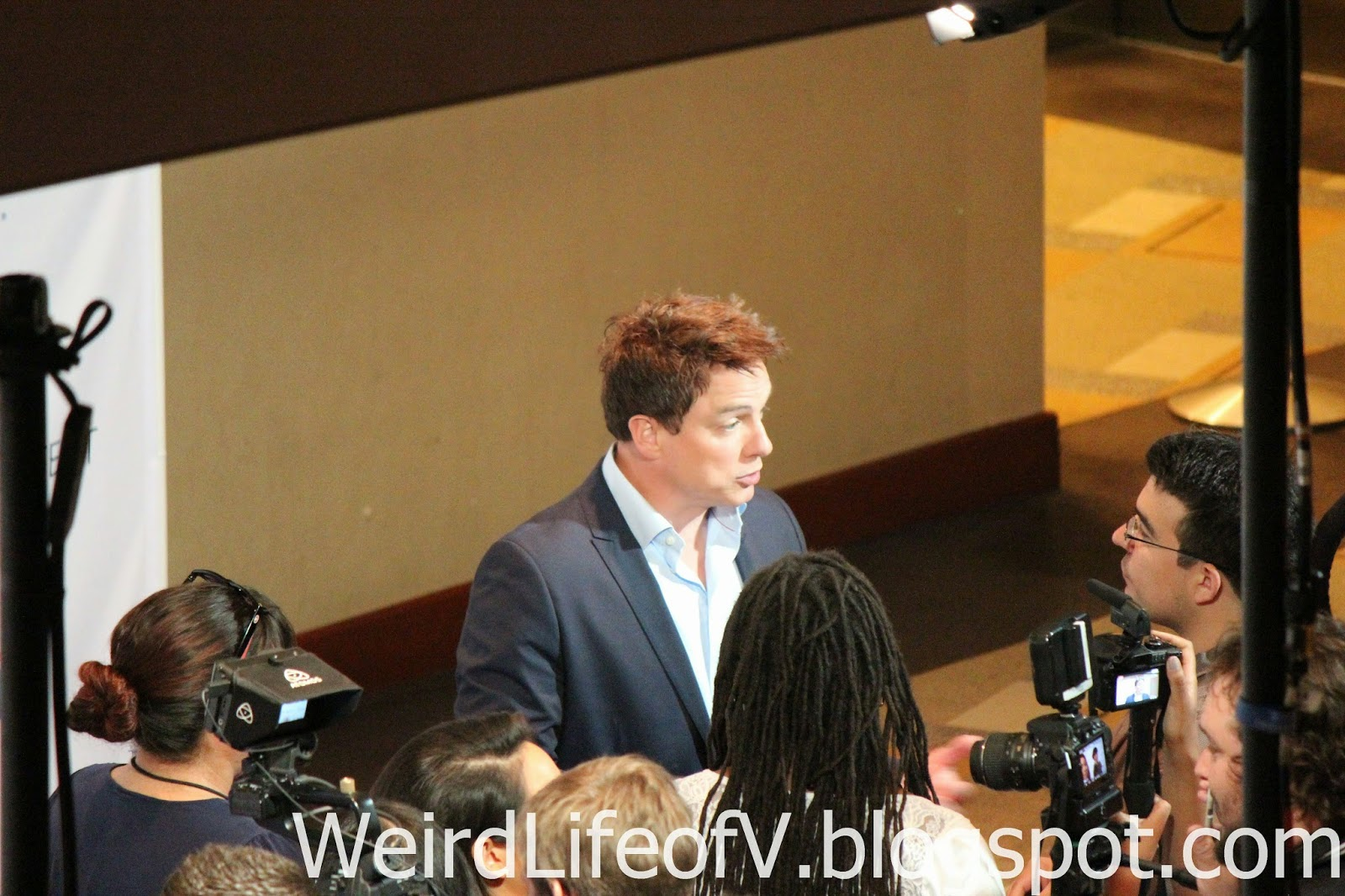 John Barrowman doing press interviews before the panel