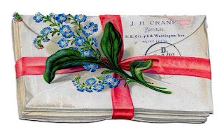 A vintage image of blue forget-me-not flowers sitting on top of a bundle of letters that are tied together with red ribbon.