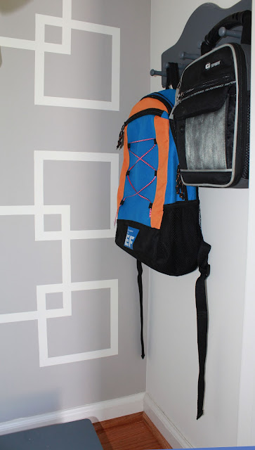 closet makeover with geometric design on wall
