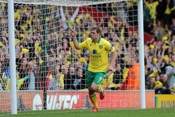 Norwich striker Grant Holt celebrates after scoring an easy goal against West Brom