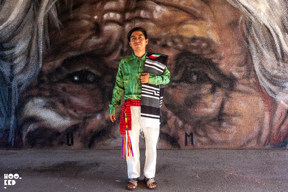 Mexico street artist Joel Merino in front of his mural in Falköping, Sweden