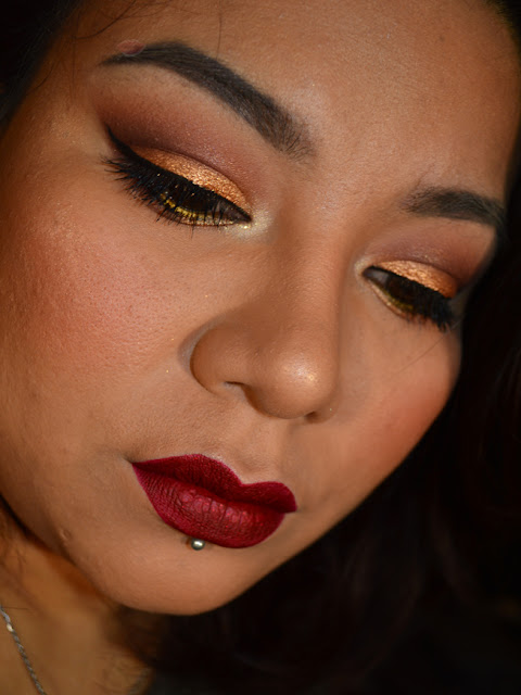 Gold eye makeup with red lips