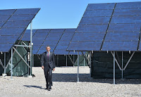 Obama walks in solar farm (Credit: technologyreview.com) Click to Enlarge.