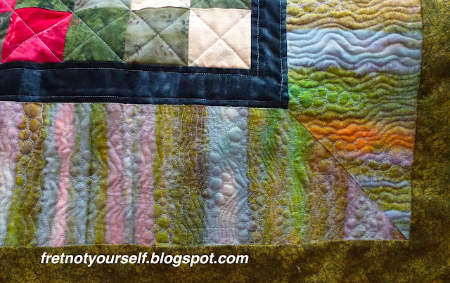 Free-motion quilting detail on border of Postage Stamp quilt