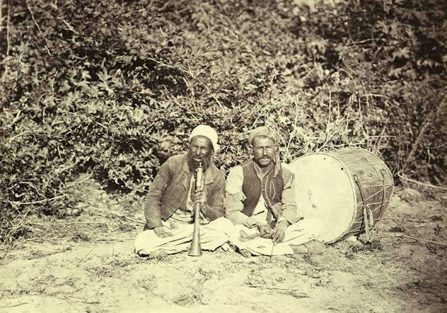 Gipsy musicians from Macedonia seated. October 1863