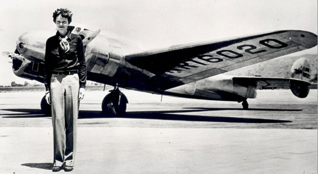 Amelia Earhart stands next to the aircraft she disappeared in
