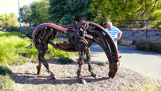 Horse metal sculpture made from farm metal and or tools