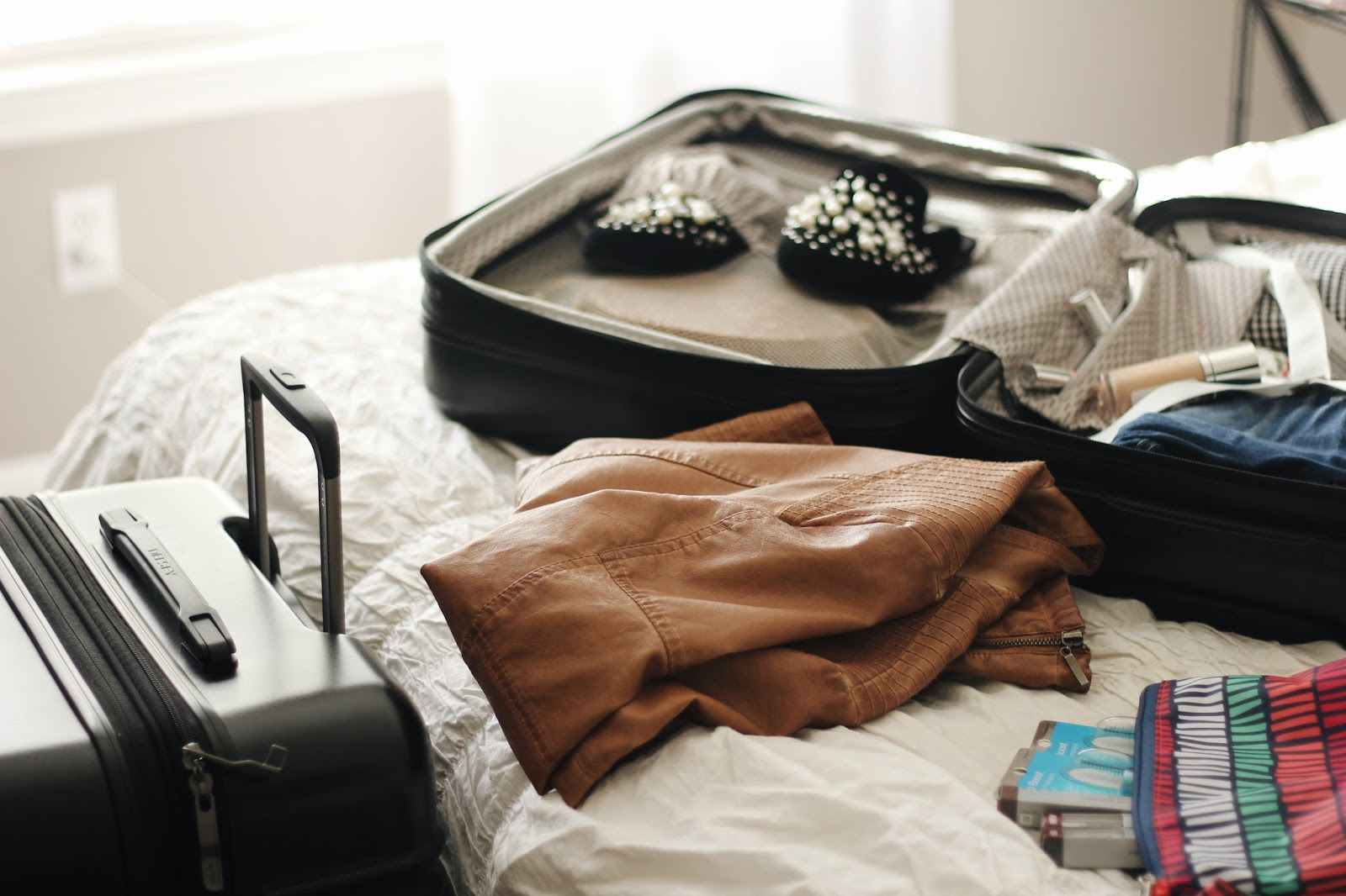 The Best Luggage For Traveling & What To Pack In Your Cosmetic Bag
