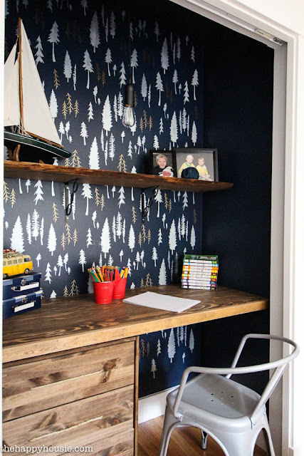 http://thehappyhousie.porch.com/closet-turned-workspace-with-a-stenciled-feature-wall/