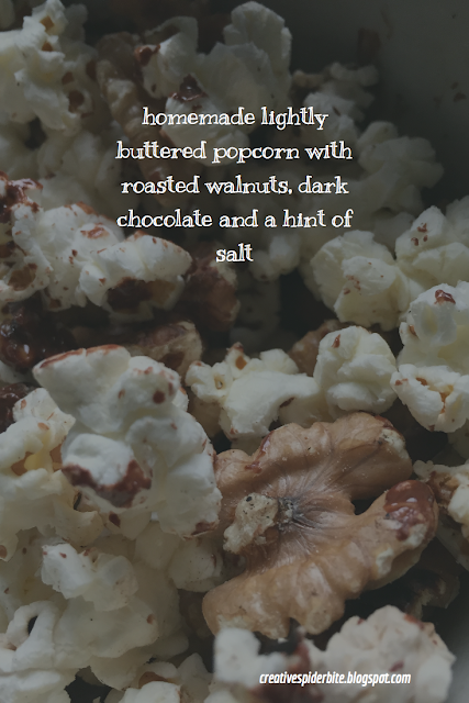 homemade lightly buttered popcorn with a roasted walnuts, dark chocolate and a hint of salt