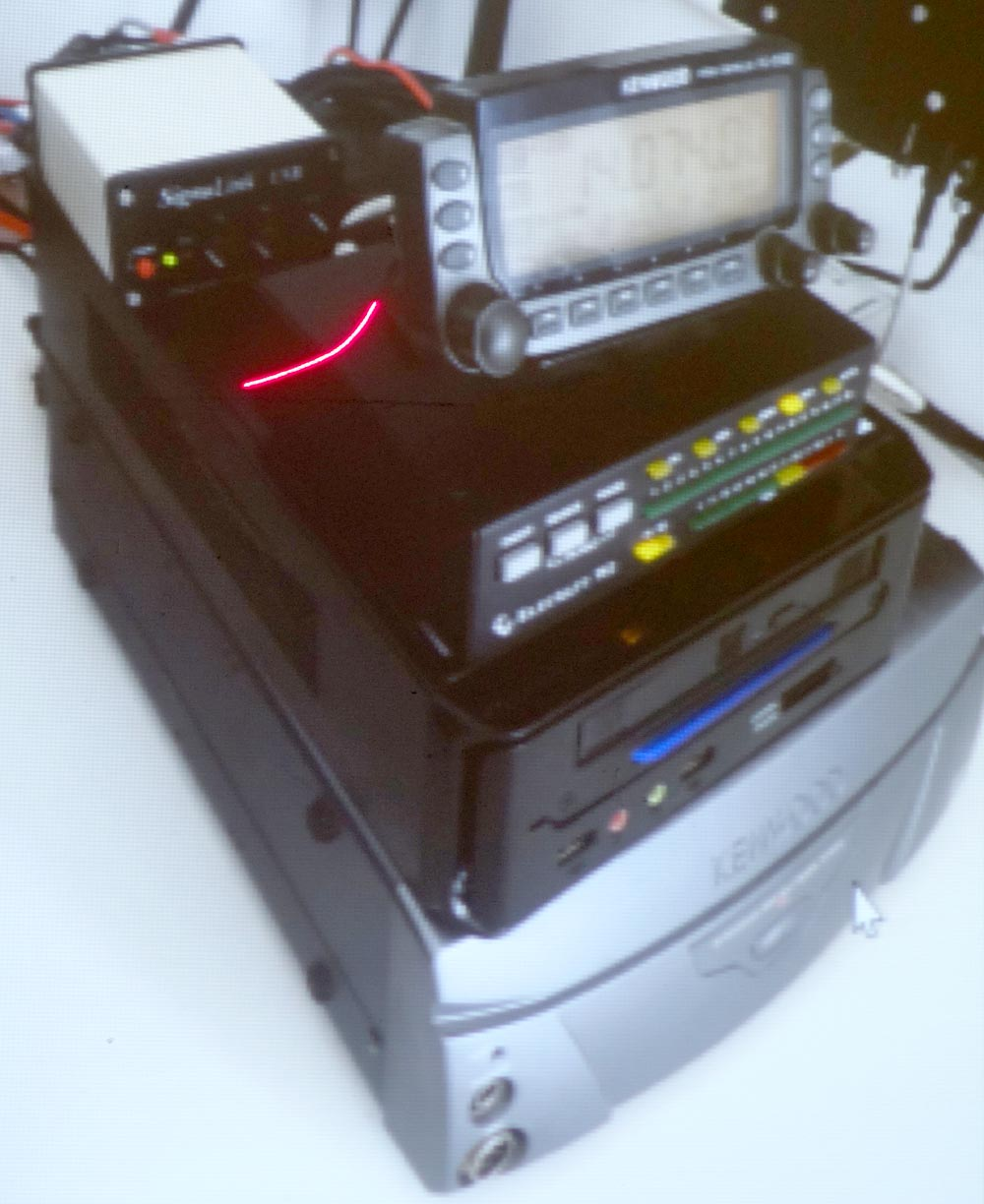 The TS-2000 rig at the bottom, control PC, SWR monitor, Signallink sound  card and detachable fascia.