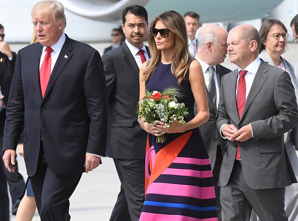 First lady Melania Trump wore a midi decoupage dress by Delpozo. for the Hamburg G20 economic summit in Hamburg, Germany