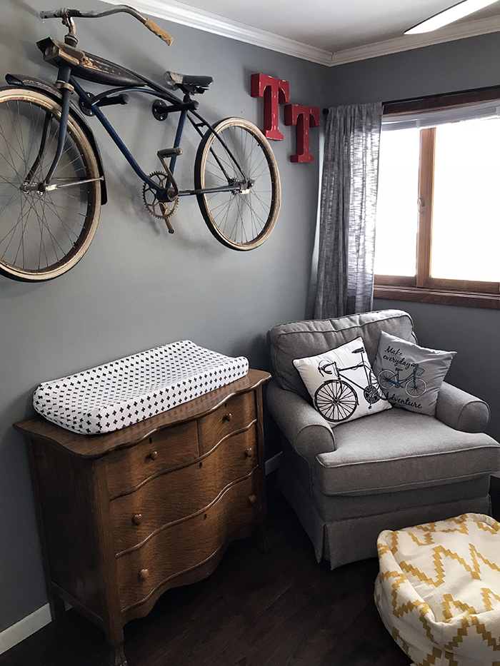 Bike inspired nursery with bike on wall