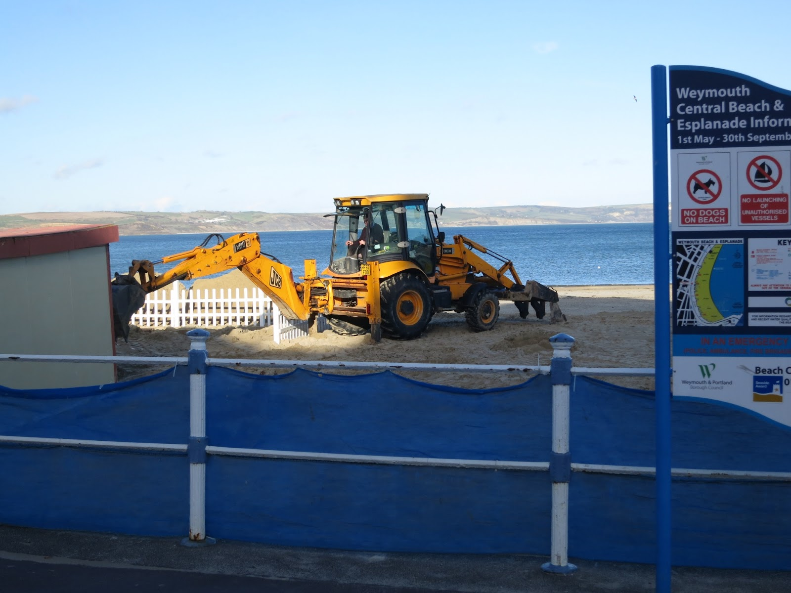 Digger digging donkey stop on Weymouth Beach.