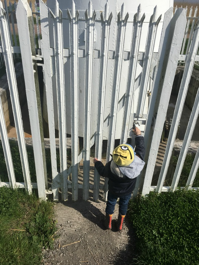 Our-weekly-journal-10-April-toddler-looking-at-lock-on-lighthouse-at-Newport-Wetlands