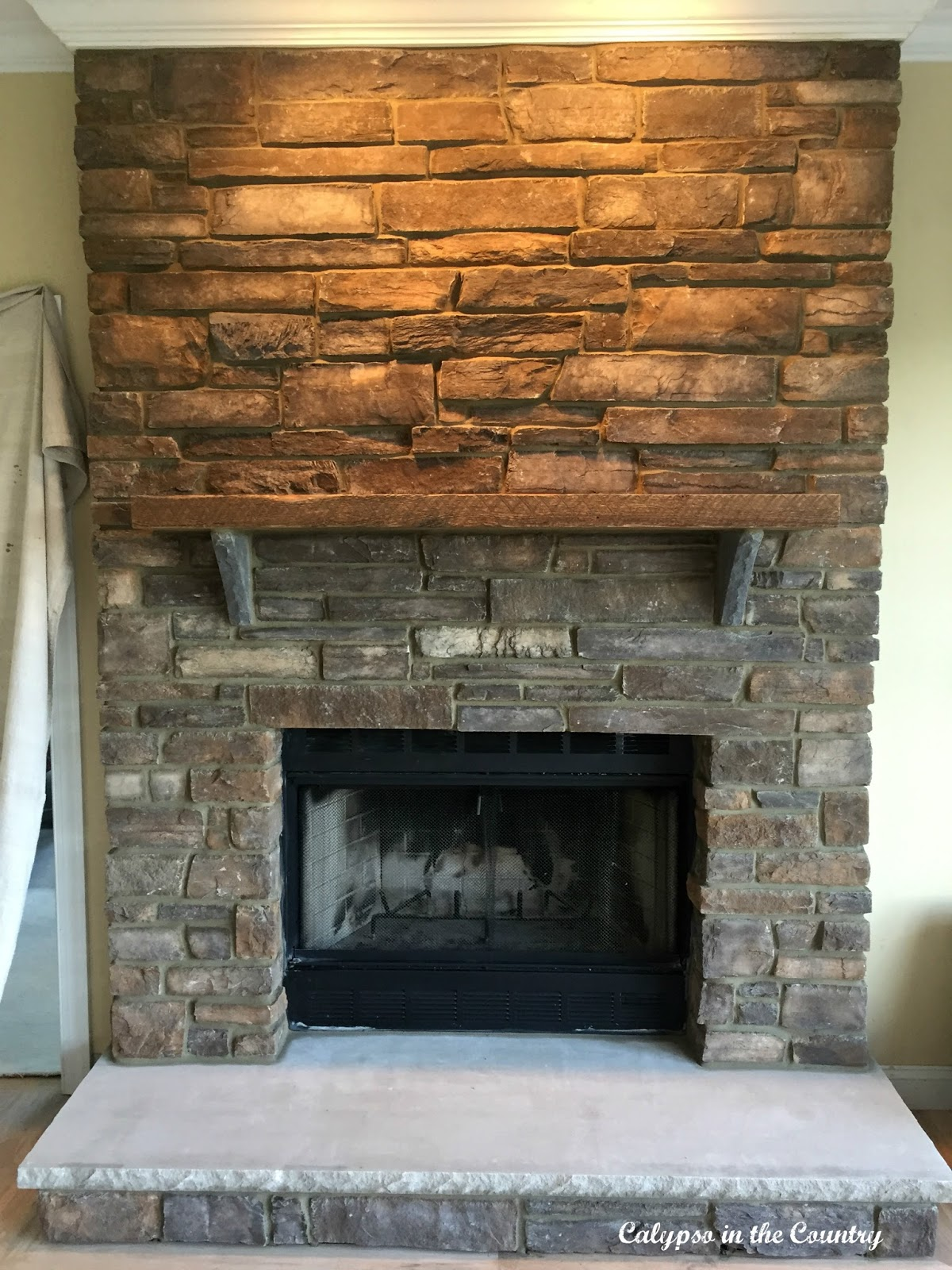 Rustic Stone fireplace after