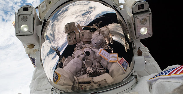 "Spacewalker Mark Vande Hei took his own photograph during the first spacewalk of 2018. These sky-high pictures are better known as ""space-selfies."" Credit: NASA"