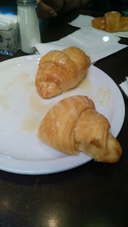 Croissants with butter at Cheddar's