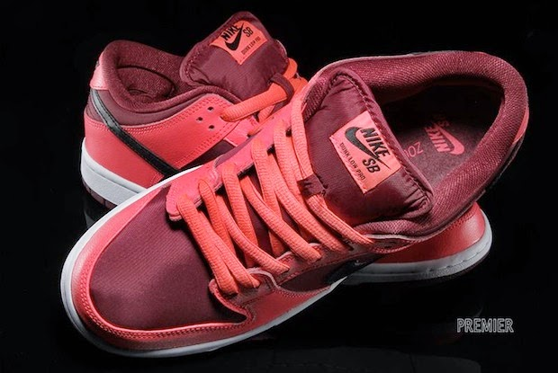 9f81783569a1 The Nike SB Laser Crimson Dunk Low is painted red with a black leather  Swoosh and a white midsole that interrupts the red party for contrast.
