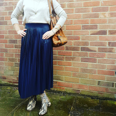 image showing pleated skirt and booties outfit