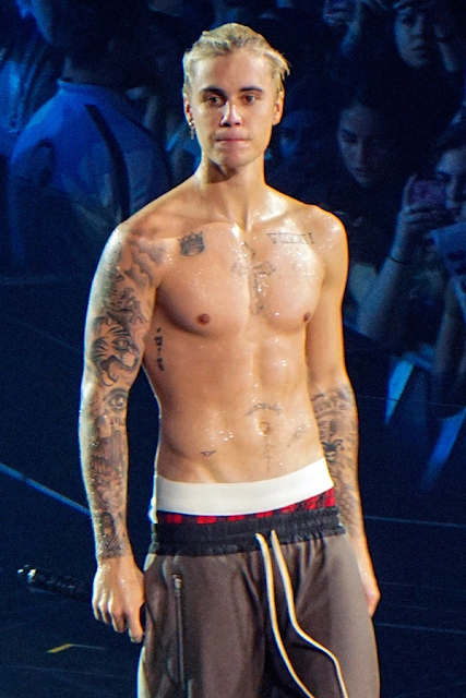 Justin Bieber Rips off Shirt
