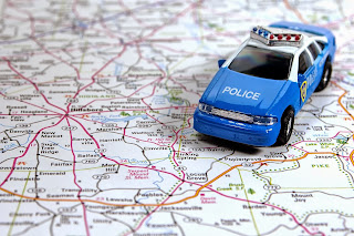 Toy police car on a map