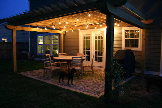 Brick patio and pergola with cafe lights | The Lowcountry Lady