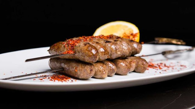 Skewered Lebanese lamb sausages in a platter