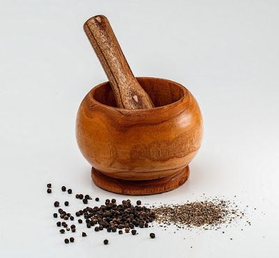 Cleaning a wooden mortar and pestle.