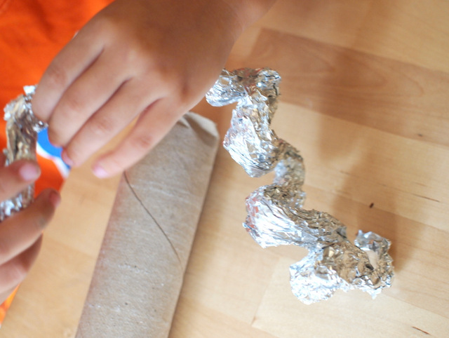 fold the aluminum foil to put inside DIY rain stick