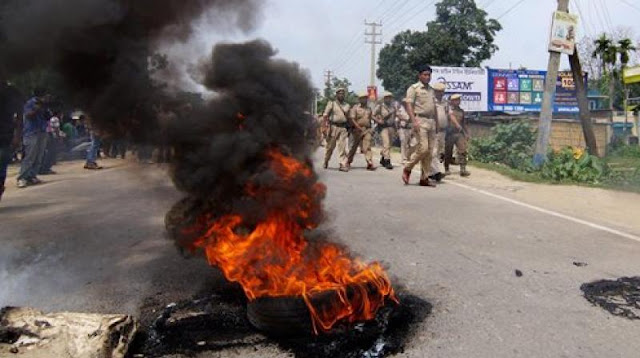People block a road with a burning tyre during a protest over the gang rape (Photo: PTI)
