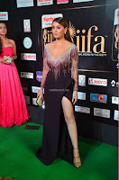 Hansika Motwani in Glittering Deep Neck Transparent Leg Split Purple Gown at IIFA Utsavam Awards 32.JPG