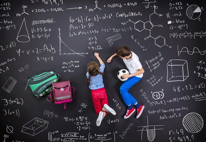 Pic of girl and boy working together surrounded by maths formulae background
