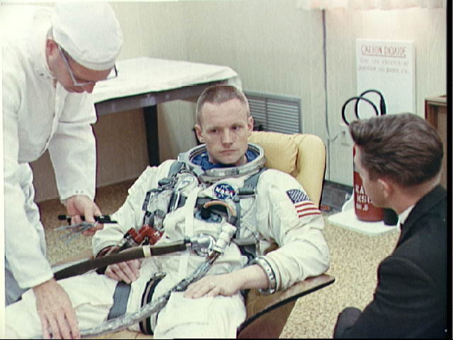 Apollo 11 Astronaut Neil Armstrong Looks Over Flight Plans