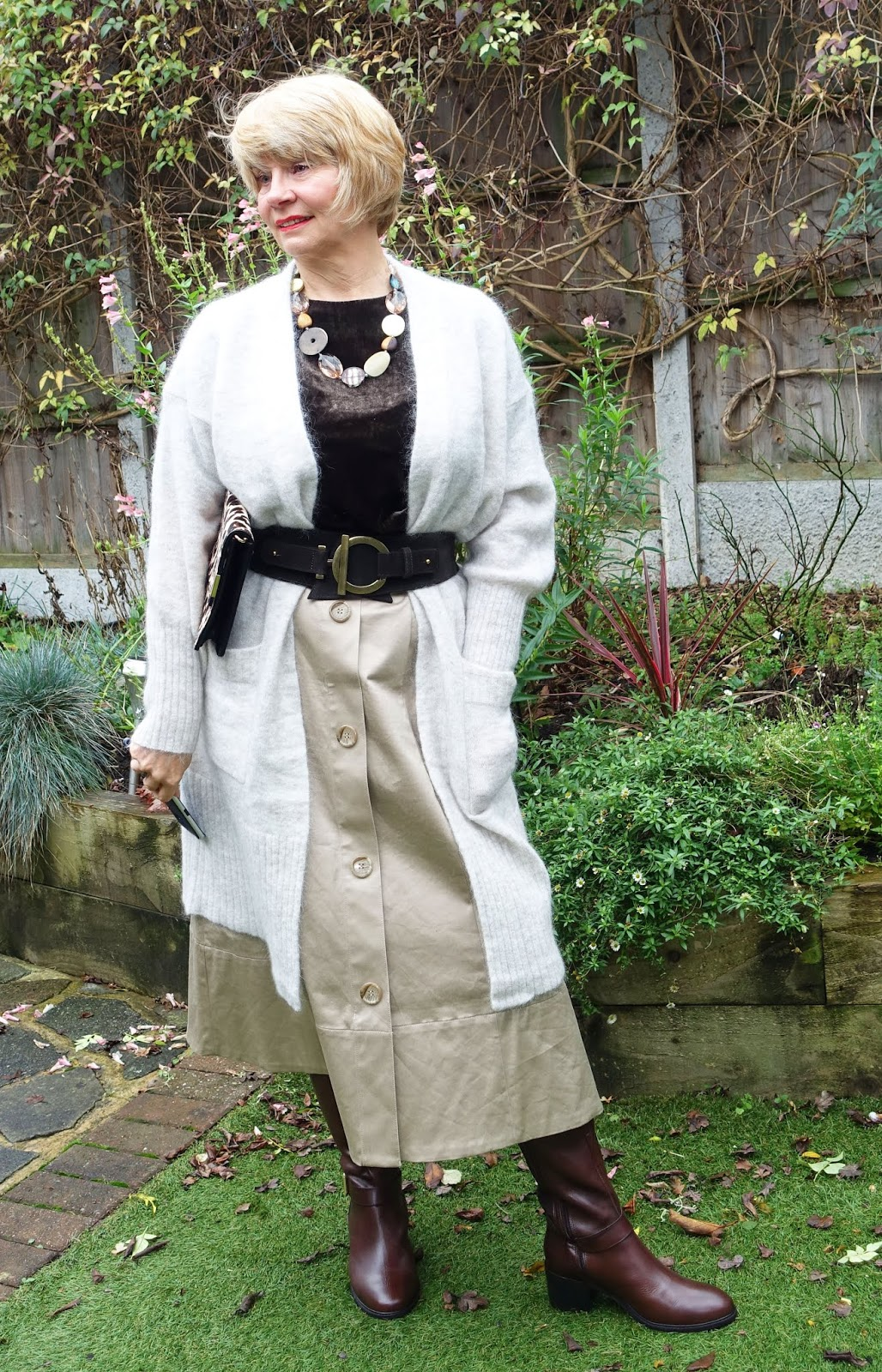 Gail Hanlon from Is This Mutton? in camel midi skirt with mushroom coatigan, brown velvet top and long brown leather boots