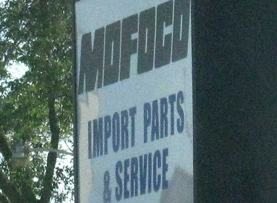 Plastic sign with name MOFOCO Auto Parts & Service