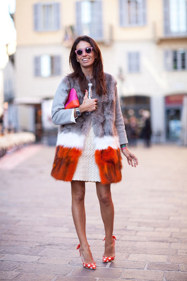 Fashion editor and stylist Viviana Volpicella wearing multi colored fur coat