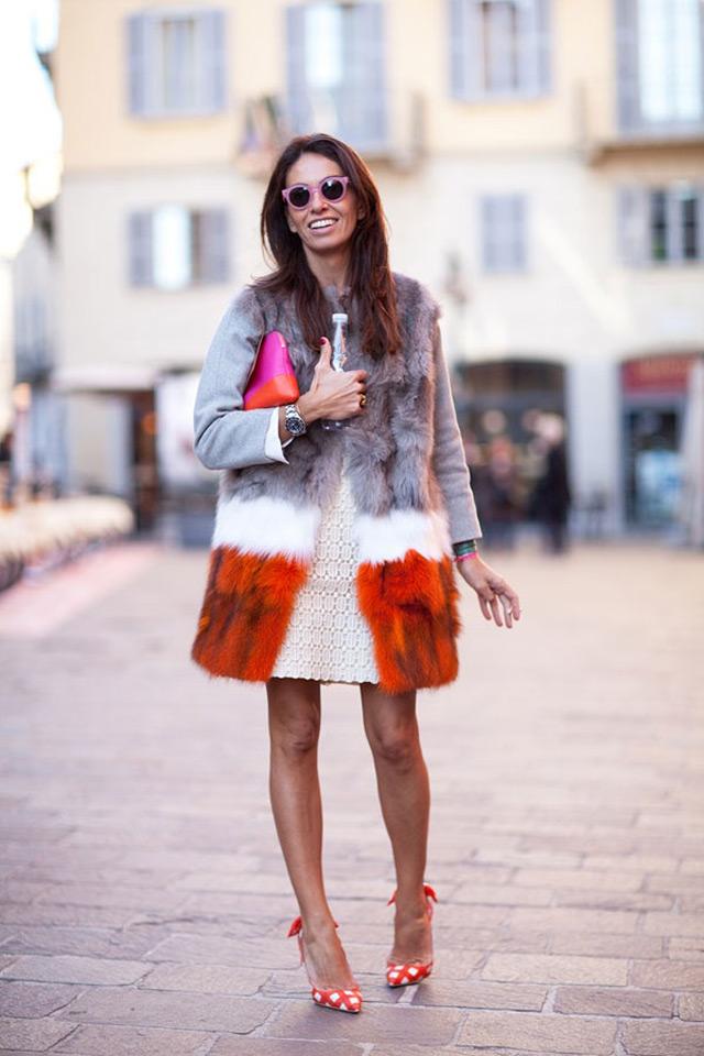 Fashion editor and stylist Viviana Volpicella wearing multi colored fur coat