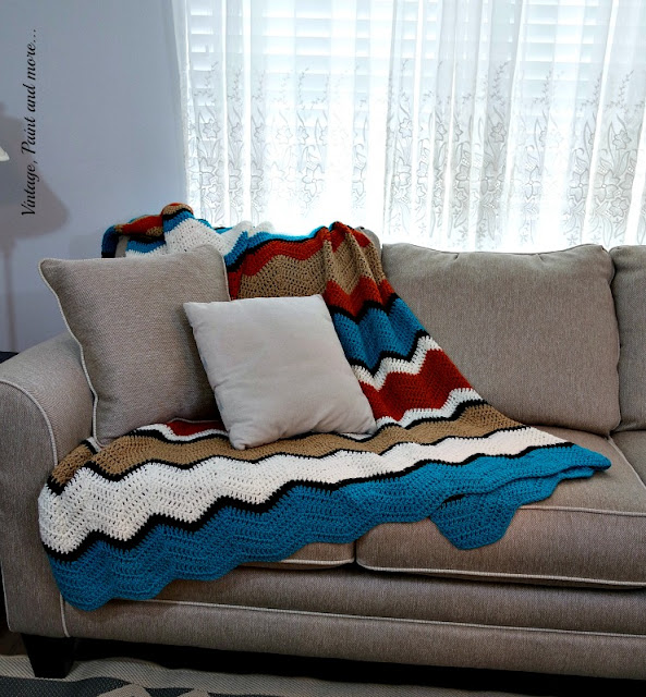 A crochet afghan done in a ripple pattern