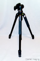 Cramer Imaging's photograph of a black tripod used in photography against a light background