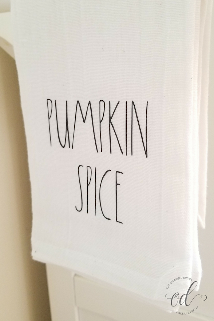 DIY pumpkin spice flour sack towel using adhesive vinyl.