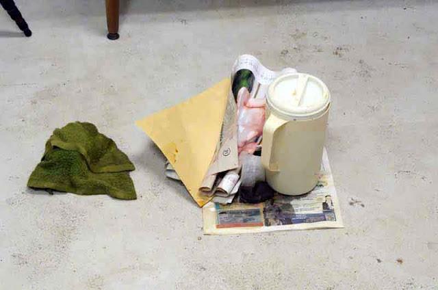 rag, newspapers, girly calendar, pitcher