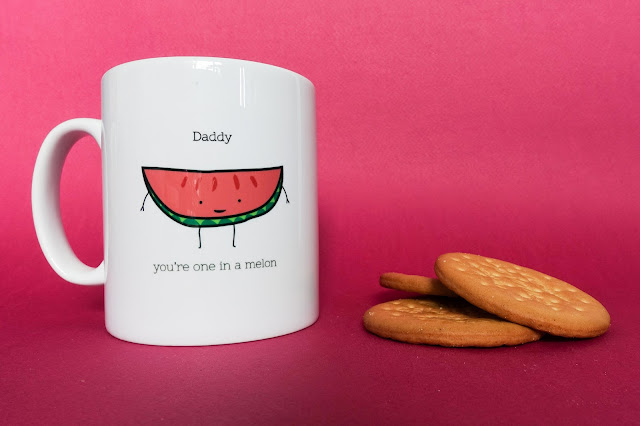 A mug with a slice of watermelon on and the message Daddy you're one in a melon. There is also a pile of rich tea bicuits